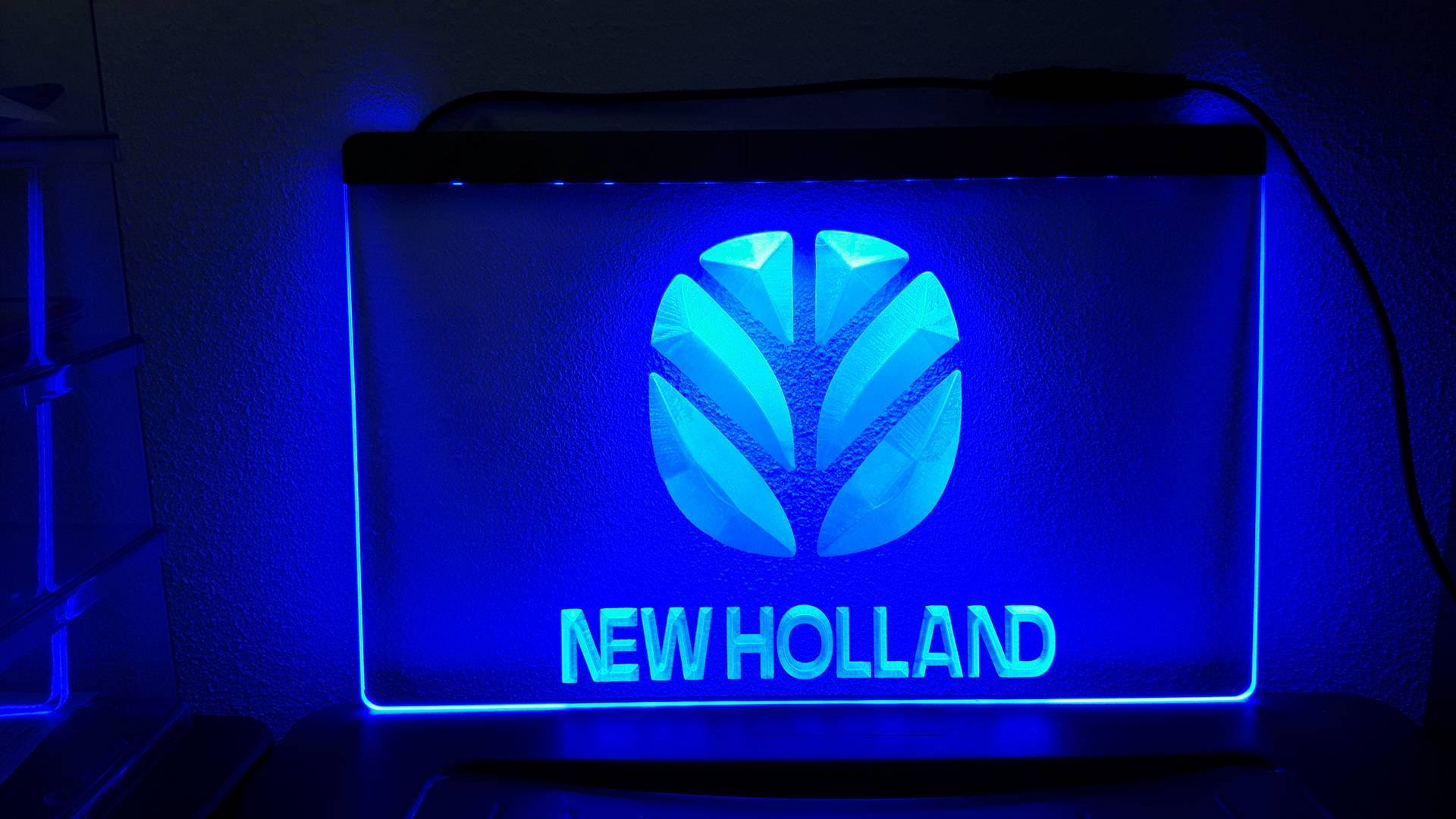 https://www.americansaleshop.nl/wp-content/uploads/2017/06/NEW-HOLLAND-BLAUW.jpg